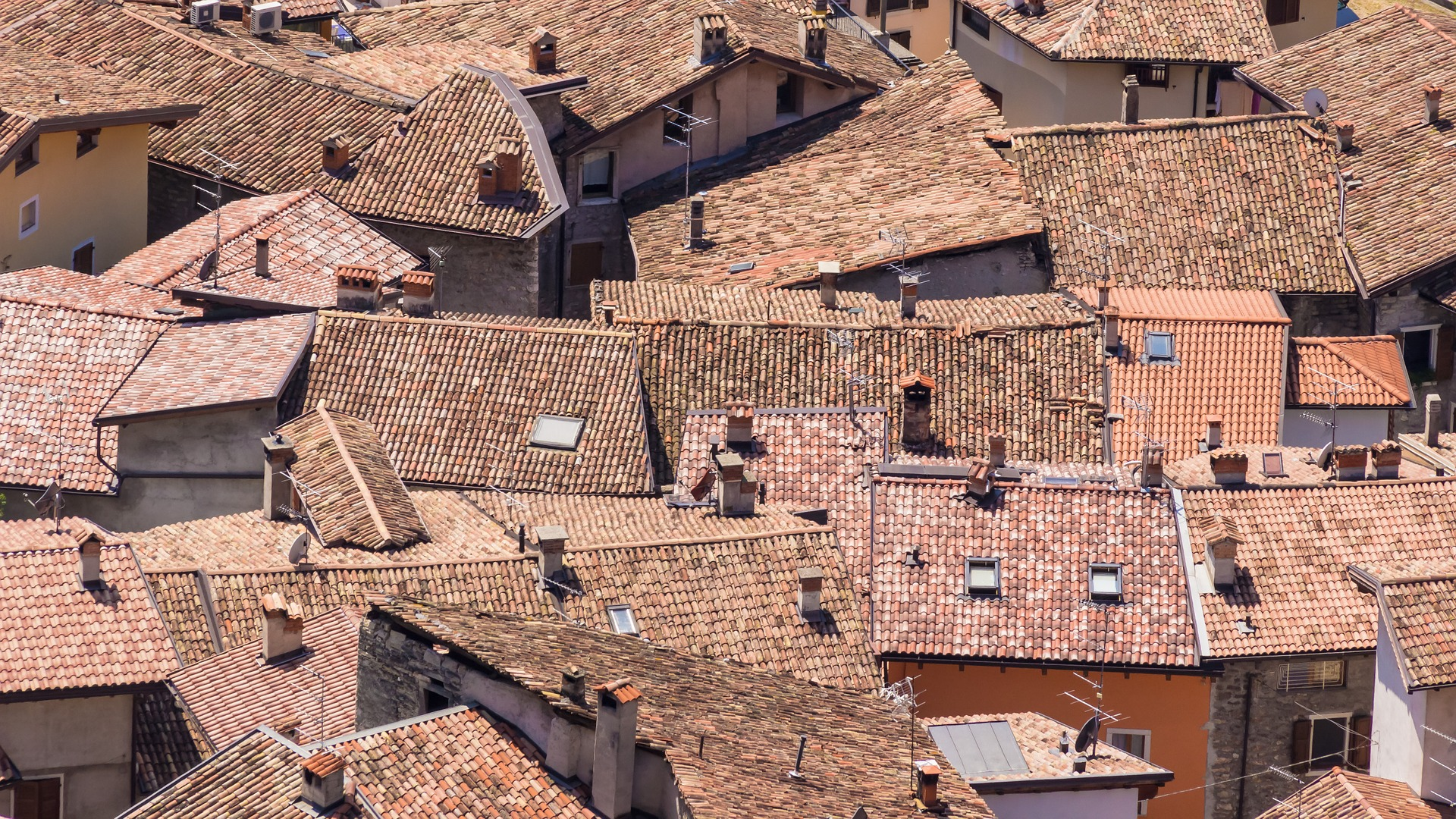 a birds eye view of a jumbled collection of roofs