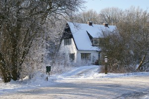 an image of a house shrouded in winter