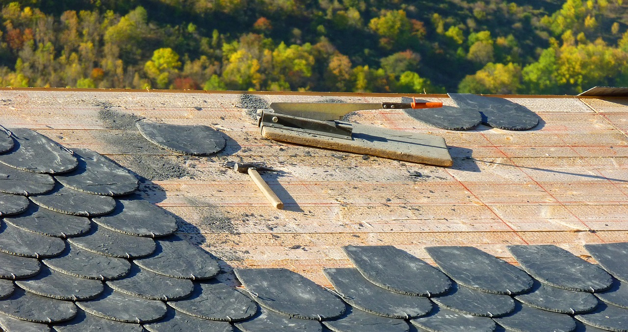 A picture of a slate roof being installed