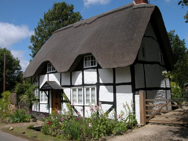 An image of a cottage with a thatched roof